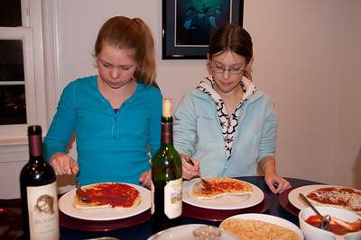Allie and Meredith making their pizzas for a pre-Valentine's Day dinner (Image taken by Kathy T. Kane on 13 Feb 2010 with Canon EOS 20D at ISO 400, f3.2, 1/250 sec and 23mm)