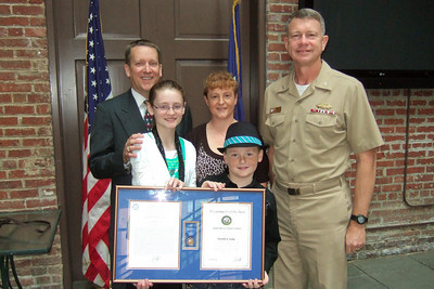 Patrick Kane, accompanied by his family, Kathy, Sydney and Christopher, and Rear Admiral Greg Shear, the Commander Naval Facilities Engineering Command (NAVFAC), after the award ceremony. Pat received the Navy Meritorious Civilian Service Award for his support of the Navy expeditionary forces ashore while serving as Deputy Director of the NAVFAC Expeditionary Programs Office (NEPO). (Image taken by Kathy T. Kane on 11 May 2010 with FinePix F10 at ISO 800, f2.8, 1/110 sec and 8mm)
