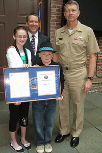 Patrick Kane, accompanied by his kids, Sydney and Christopher, and Rear Admiral Greg Shear, the Commander Naval Facilities Engineering Command (NAVFAC), after the award ceremony. Pat received the Navy Meritorious Civilian Service Award for his support of the Navy expeditionary forces ashore while serving as Deputy Director of the NAVFAC Expeditionary Programs Office (NEPO). (Image taken by Kathy T. Kane on 11 May 2010 with FinePix F10 at ISO 800, f2.8, 1/120 sec and 8mm)