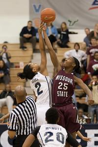 #25 Tia Mays of Missouri State gets the opening tip off over #2 Tia Magee of Georgetown in the Georgetown Hoyas and Missouri State University Lady Bears women's basketball game. The Hoyas won 72-59, improving to 9-3 on the season. (Image taken by Patrick R. Kane on 19 Dec 2010 with Canon EOS-1D Mark III at ISO 1600, f2.8, 1/320 sec and 115mm)