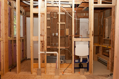 The 1st floor is ready for the concealment inspection. Looking from the kitchen through the wall you'll see the guest room closet on the left, the shower straight ahead, the carrier for the wall hung toilet to the right and at the far right the framing for the vanity. (Image taken by Patrick R. Kane on 05 Aug 2011 with Canon EOS-1D Mark III at ISO 400, f5.6, 1/60 sec and 16mm)