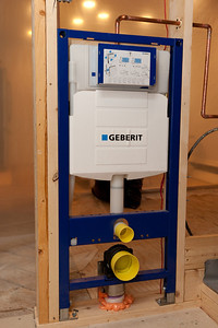 Geberit Duravit 111335005 in-wall tank and carrier for the wall hung toilet. The only way to meet code (21-inches clear in front of the toilet) was to install a wall-hung toilet. (Image taken by Patrick R. Kane on 05 Aug 2011 with Canon EOS-1D Mark III at ISO 400, f5.6, 1/60 sec and 27mm)