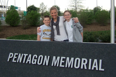 Christopher, Anita (Kathy's neice) and Sydney at the Pentagon Memorial, just before they were caught in a heavy downpour. Our next stop was a self-guided tour of the Pentagon--apparently they'll let anybody in ;-) (Image taken by Kathy T. Kane on 19 Apr 2011 with FinePix F10 at ISO 200, f2.8, 1/250 sec and 8mm)