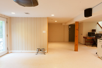Basement before demolition. The wall next to the dog bowls will come out as well as the old laundry room and half bath behind it. (Image taken by Patrick R. Kane on 22 Jul 2011 with Canon EOS-1D Mark III at ISO 800, f11.0, 1/0.3 sec and 20mm)