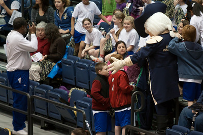 Christopher checking out George Washington with the rest of the Taylor Elementary School's 5th Grade Dance Team that have come to perform during half-time at the George Washington University and Richmond women's basketball game. The dancers did a great job. Unfortunately for the Colonials, they let their 35-30 advantage at half-time slip away in a 55-68 loss to the Spiders. (Image taken by Patrick R. Kane on 08 Jan 2011 with Canon EOS-1D Mark III at ISO 800, f2.8, 1/400 sec and 200mm)