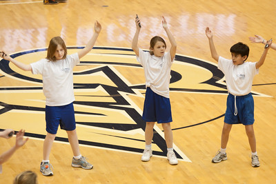 Ellie, Katie and Ben performing with the Taylor Elementary School's 5th Grade Dance Team during half-time at the George Washington University and Richmond women's basketball game. The dancers did a great job. Unfortunately for the Colonials, they let their 35-30 advantage at half-time slip away in a 55-68 loss to the Spiders. (Image taken by Patrick R. Kane on 08 Jan 2011 with Canon EOS-1D Mark III at ISO 800, f2.8, 1/500 sec and 130mm)