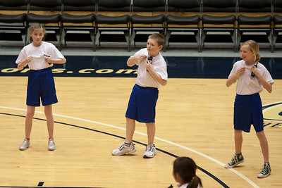 Lydia, Christopher and Lucy performing with the Taylor Elementary School's 5th Grade Dance Team during half-time at the George Washington University and Richmond women's basketball game. The dancers did a great job. Unfortunately for the Colonials, they let their 35-30 advantage at half-time slip away in a 55-68 loss to the Spiders. (Image taken by Patrick R. Kane on 08 Jan 2011 with Canon EOS-1D Mark III at ISO 800, f2.8, 1/500 sec and 155mm)