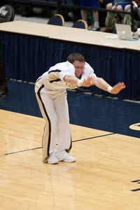 A cheerleader performing during a break in the George Washington University and Richmond women's basketball game. The Colonials let their 35-30 advantage at half-time slip away in a 55-68 loss to the Spiders. (Image taken by Patrick R. Kane on 08 Jan 2011 with Canon EOS-1D Mark III at ISO 800, f2.8, 1/500 sec and 170mm)