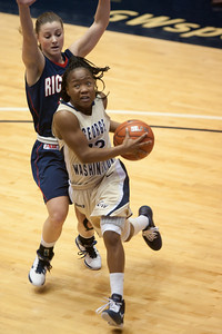 #12 Danni Jackson of the George Washington University women's basketball team playing against the Richmond Spiders. The Colonials let their 35-30 advantage at half-time slip away in a 55-68 loss to the Spiders. (Image taken by Patrick R. Kane on 08 Jan 2011 with Canon EOS-1D Mark III at ISO 800, f2.8, 1/500 sec and 165mm)