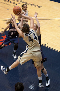 #44 Sara Mostafa of the George Washington University women's basketball team playing against the Richmond Spiders. The Colonials let their 35-30 advantage at half-time slip away in a 55-68 loss to the Spiders. (Image taken by Patrick R. Kane on 08 Jan 2011 with Canon EOS-1D Mark III at ISO 800, f2.8, 1/500 sec and 70mm)