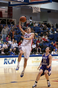 #15 Lisa Strack of the American University women's basketball team playing against the Holy Cross Crusaders. The Eagles beat the Crusaders 84 to 53. (Image taken by Patrick R. Kane on 22 Jan 2011 with Canon EOS-1D Mark III at ISO 1600, f2.8, 1/320 sec and 95mm)