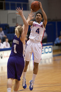 #4 Geleisa George of the American University women's basketball team playing against the Holy Cross Crusaders. The Eagles beat the Crusaders 84 to 53. (Image taken by Patrick R. Kane on 22 Jan 2011 with Canon EOS-1D Mark III at ISO 1600, f2.8, 1/320 sec and 155mm)