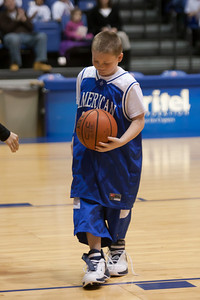 Christopher just won a competition during a time-out in the American University and Holy Cross women's basketball game. Christopher and Nick had to go from one end of the court to the other, getting dressed along the way in extra large shorts, a jersey and shoes, then finish with a layup. Christopher finished first and then watched the Eagles beat the Crusaders 84 to 53. (Image taken by Patrick R. Kane on 22 Jan 2011 with Canon EOS-1D Mark III at ISO 1600, f2.8, 1/320 sec and 120mm)