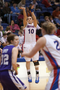 #10 Nicole Ryan of the American University women's basketball team playing against the Holy Cross Crusaders. The Eagles beat the Crusaders 84 to 53. (Image taken by Patrick R. Kane on 22 Jan 2011 with Canon EOS-1D Mark III at ISO 1600, f2.8, 1/320 sec and 173mm)