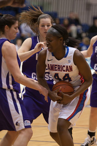 #44 Stephanie Anya of the American University women's basketball team playing against the Holy Cross Crusaders. The Eagles beat the Crusaders 84 to 53. (Image taken by Patrick R. Kane on 22 Jan 2011 with Canon EOS-1D Mark III at ISO 1600, f2.8, 1/320 sec and 140mm)