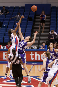 #44 Stephanie Anya getting the opening tip off of the American University and Holy Cross women's basketball game. The Eagles beat the Crusaders 84 to 53. (Image taken by Patrick R. Kane on 22 Jan 2011 with Canon EOS-1D Mark III at ISO 1600, f2.8, 1/320 sec and 105mm)