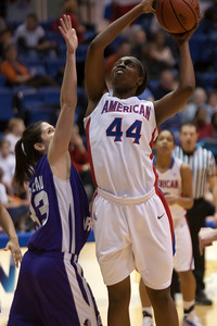 #44 Stephanie Anya of the American University women's basketball team playing against the Holy Cross Crusaders. The Eagles beat the Crusaders 84 to 53. (Image taken by Patrick R. Kane on 22 Jan 2011 with Canon EOS-1D Mark III at ISO 1600, f2.8, 1/320 sec and 150mm)