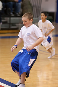 Christopher approaching the jersey as he competes against Nick during a time-out in the American University and Holy Cross women's basketball game. Christopher and Nick had to go from one end of the court to the other, getting dressed along the way in extra large shorts, a jersey and shoes, then finish with a layup. Christopher finished first and then watched the Eagles beat the Crusaders 84 to 53. (Image taken by Patrick R. Kane on 22 Jan 2011 with Canon EOS-1D Mark III at ISO 1600, f2.8, 1/320 sec and 130mm)