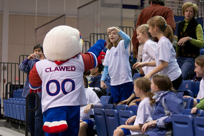 Clawed the Eagle and the Taylor Elementary School's 5th Grade Dance Team enjoying the American University and Holy Cross women's basketball game, where they'll perform at half-time. The dancers did a great job, as did the Eagles, who beat the Crusaders 84 to 53. (Image taken by Patrick R. Kane on 22 Jan 2011 with Canon EOS-1D Mark III at ISO 1600, f2.8, 1/320 sec and 70mm)
