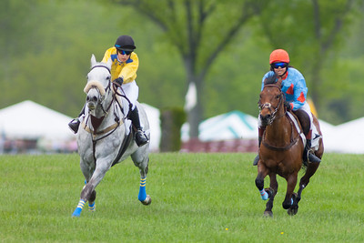 Junior Field Masters Chase winner, Questioning (4), ridden by Zoe Valvo pulls ahead of Jordan (1), a large pony ridden by Erin Swope. The 86th running of the Virginia Gold Cup steeplechase race at Great Meadow in The Plains, Virginia (Image taken by Patrick R. Kane on 07 May 2011 with Canon EOS-1D Mark III at ISO 100, f3.5, 1/500 sec and 400mm)