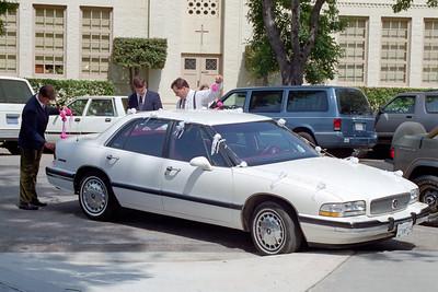 Steve Smuck, Chip Nixon and Dave Eggers decorating the car at Pat & Kathy Kane's wedding, May 30, 1992.
