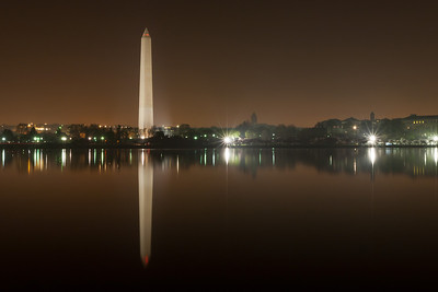 The Washington Monument and its reflection on the Tidal Basin. This year's National Cherry Blossom Festival honors the 100-year anniversary of the gift of trees (Image taken by Patrick R. Kane on 23 Mar 2012 with Canon EOS 5D at ISO 200, f22.0, 1/30 sec and 35mm)