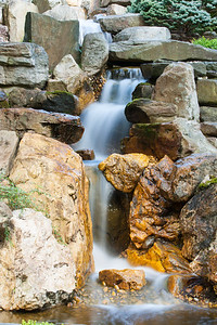 A waterfall in the Japanese-style Garden at Hillwood Estate, Museum & Gardens (Image taken by Patrick R. Kane on 29 Sep 2012 with Canon EOS-1D Mark III at ISO 100, f32.0, 1/2 sec and 70mm)