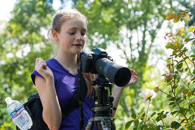 Sydney taking a close-up picture of a rose in the rose garden of Hillwood Estate, Museum & Gardens (Image taken by Patrick R. Kane on 29 Sep 2012 with Canon EOS-1D Mark III at ISO 100, f8.0, 1/30 sec and 120mm)
