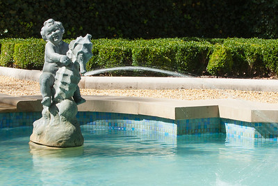 A cherub riding a sea animal in the central pool of the French Parterre at Hillwood Estate, Museum & Gardens (Image taken by Patrick R. Kane on 29 Sep 2012 with Canon EOS-1D Mark III at ISO 100, f20.0, 1/30 sec and 70mm)