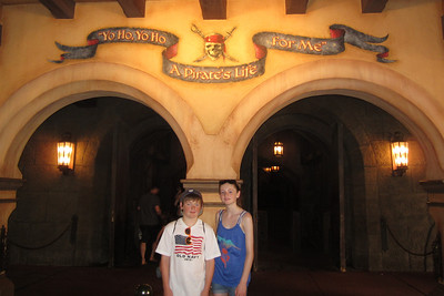 Christopher and Sydney in front of the Pirates of the Caribbean ride at Disney's Magic Kingdom (Image taken by Kathy L. Kane on 27 May 2012 with Canon PowerShot ELPH 100 HS at ISO 0, f3.2, 1/60 sec and 6mm)