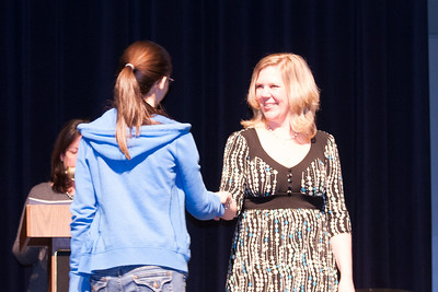 Olivia receiving an award. Each winter, the Arlington Central Library hosts the Regional Scholastic Art Award, a competition which encompasses all Middle School and High School students in Arlington County. Almost 2,000 works of art were submitted and judged by three jurors. Out of these, the judges chose 376 to be awarded either a Gold or a Silver Certificate. The awards ceremony was held at Washington-Lee High School. (Image taken by Kathy T. Kane on 07 Mar 2012 with Canon EOS 20D at ISO 800, f4.0, 1/30 sec and 85mm)