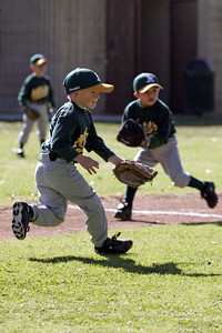 Christopher fielding a grounder during an opening day game. Yankees vs. Athletics, 2006 North Side Little League Baseball, Tee Ball Division