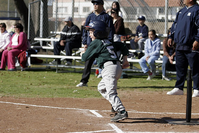 Christopher hits a single during an opening day game. Yankees vs. Athletics, 2006 North Side Little League Baseball, Tee Ball Division