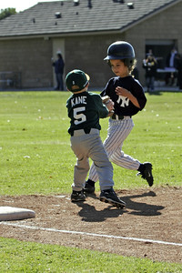 Christopher tagging the runner at 3rd base during an opening day game. Yankees vs. Athletics, 2006 North Side Little League Baseball, Tee Ball Division