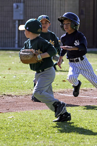 Christopher about to tag out the runner during an opening day game. Yankees vs. Athletics, 2006 North Side Little League Baseball, Tee Ball Division