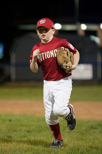 Christopher heading in after fielding the ball to end the 2nd inning. The Nationals came up a little short in an exciting finish and were outscored by the Brewers 6-8. They are now 1-1 for the season. 2010 Arlington Little League Baseball, Majors Division. Nationals vs Brewers (14 Apr 2010) (Image taken by Patrick R. Kane on 14 Apr 2010 with Canon EOS-1D Mark II at ISO 1600, f2.8, 1/320 sec and 173mm)
