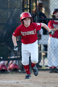 Christopher's hit is fielded to end the 5th inning with the Nationals leading 5-2. The Nationals won their season opener against the Rays 7-6 in an exciting, come from behind finish. They are now 1-0 for the season. 2010 Arlington Little League Baseball, Majors Division. Nationals vs Rays (10 Apr 2010) (Image taken by Patrick R. Kane on 10 Apr 2010 with Canon EOS-1D Mark II at ISO 400, f2.8, 1/320 sec and 300mm)