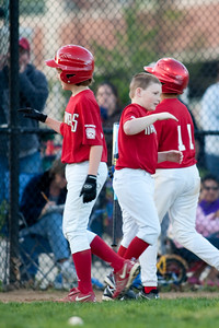 Christopher congratulates Gabe on his game-winning double. The Nationals won their season opener against the Rays 7-6 in an exciting, come from behind finish. They are now 1-0 for the season. 2010 Arlington Little League Baseball, Majors Division. Nationals vs Rays (10 Apr 2010) (Image taken by Patrick R. Kane on 10 Apr 2010 with Canon EOS-1D Mark II at ISO 400, f2.8, 1/250 sec and 300mm)