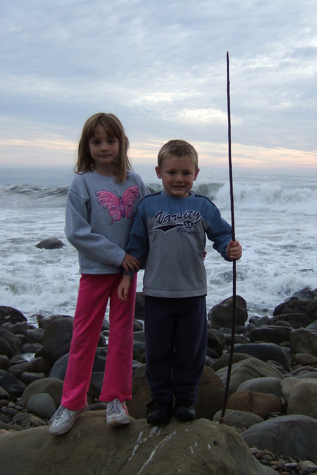 Sydney and Christopher, enjoying watching the big waves at El Capitan State Beach during a camping trip.