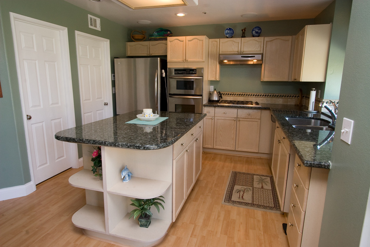 """Granite Counters (Sep 2005). We finally decided to replace the white tile counter tops with a nice granite. Pat did the demo and prep work, as well as the tumbled marble back splash. After it was all done, we wondered why we waited so long!  <A HREF=""""http://kanefamily.smugmug.com/gallery/3846149"""">Photo Album</A>"""
