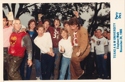 From R to L starting with Kevin Holt in coveralls, Ginny Stover, Bruce Monroe (numbered jersey), ? (glasses) and Patrick Kane. TAMU Elephant Walk, College Station, Texas, November 24, 986