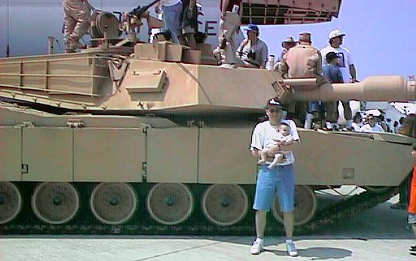 Sydney and Pat next to Army M1A2 tank during the 1998 DOD Joint Services Open House at Andrews Air Force Base.