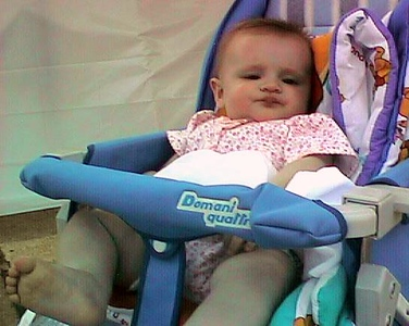 """""""Mom, I'll have my pears please, and Dad, please rub my feet."""" Sydney relaxing during the 1998 DOD Joint Services Open House at Andrews Air Force Base."""