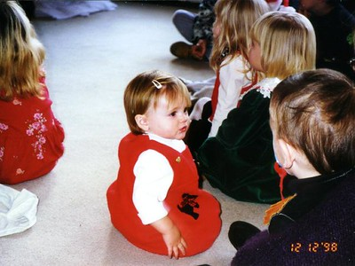 """Sydney Jean Kane at the Kennedy-Warren children's Christmas party. Everyone is listening to Santa Claus tell the story of """"How the Grinch Stole Christmas."""""""