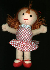 The little doll that the girls received from Santa Claus at the Kennedy-Warren's children's Christmas party. The boys were given a little Santa Claus.
