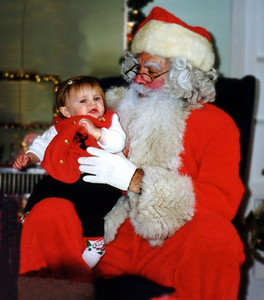 Sydney Jean Kane briefly sitting on Santa's lap. This Santa was quite good. Fun was had by all at the Kennedy-Warren children's Christmas party.