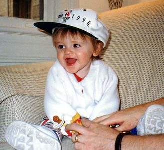 Sydney Jean Kane with Daddy's hat. She is getting pretty adept at rummaging through our dresser. Mommy found her trying to put on the hat and decided to have Daddy help her.