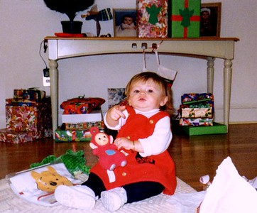 Christmas Day. Sydney Jean Kane beginning to open her packages. Her first present, Po from the Teletubbies, could have probably been her last. She just loved it.
