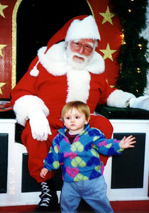 Sydney Jean Kane with the Coliseum Mall Santa. This is as close as she'd get without Mommy. Newport News VA.