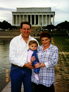 Pat, Kathy and Sydney Kane in pursuit of a picture for their 1998 Christmas card. In front of Lincoln Memorial.